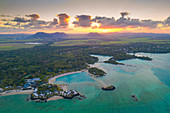 Sunset over luxury resort in the turquoise lagoon, aerial view, Trou d'Eau Douce, Flacq, Indian Ocean, East coast, Mauritius