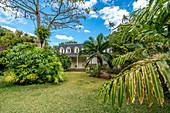 Lush tropical gardens of Eureka La Maison Creole, colonial house, Montagne Ory, Moka, Indian Ocean, Mauritius