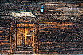 Wood facade and doorway of alpine chalet, Bettmeralp, canton of Valais, Switzerland