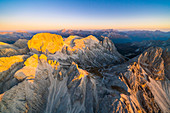 Catinaccio Group lit by warm sunset in autumn, aerial view Sciliar-Catinaccio Natural Park, Dolomites, South Tyrol, Italy