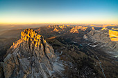 Sunset over Sassolungo and the Odle group in autumn, aerial view, Dolomites, South Tyrol, Italy