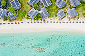 Luxury tourist resort on tropical white sand beach, aerial view, Le Morne Brabant peninsula, Black River, Indian Ocean, Mauritius