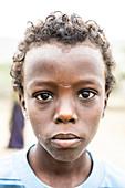 Sad looking boy, Melabday, Asso Bhole, Danakil Depression, Afar Region, Ethiopia, Africa