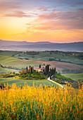 Farmhouse at sunrise near San Quirico d'Orcia, Siena Province, Tuscany, Italy.