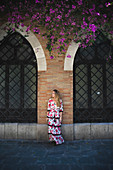 A girl in a typical spanish dress in Seville, Andalucia, Spain