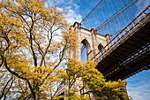 Brooklyn bridge during a sunny day; Brooklyn, New York city.
