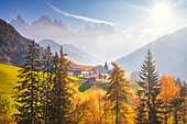 Funes Valley, Bolzano province, South Tyrol, Italy. Autumnal colors during a sunny day with Odle mountain on the background.