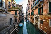 Quiet canal in Venice, Veneto, Italy.