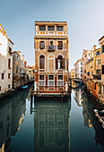A palace between two canals in Venice, Veneto, Italy.