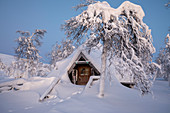 Typical wood chalet called Pallas Kota inside Pallas-Yllastunturi National Park, Muonio, Lapland, Finland