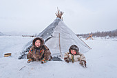 Two small nenets boys at the nomadic reindeer herders camp. Polar Urals, Yamalo-Nenets autonomous okrug, Siberia, Russia