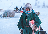 Nenets woman dressed in the traditional way at the nomadic reindeer herders camp. Polar Urals, Yamalo-Nenets autonomous okrug, Siberia, Russia