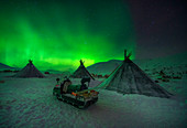 Northern lights at the nomadic reindeer herders camp. Polar Urals, Yamalo-Nenets autonomous okrug, Siberia, Russia