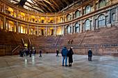 Tourists admiring Teatro Farnese (Farnese Theatre) within the building complex of Palazzo della Pilotta, Parma, Emilia Romagna, Italy, Europe.
