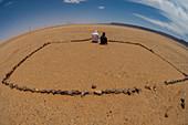 Touaregs praying towards Mecca, Sahara desert, Fezzan, Libya.
