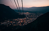 View from the aerial cable car across the city of Bolzano, Lombardy, Italy in the evening.