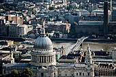 High angle view of the dome of St Paul's Cathedral designed by Christopher Wren, and Millennium Bridge and Tate Modern across the River Thames in London
