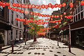 View of empty street in Chinatown decorated with red lanterns during the Corona virus crisis