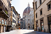 View down an empty street towards the Duomo di Santa Maria del Fiore in Florence, Italy during the Corona virus crisis.