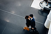 Couple in business suits kissing