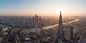 Aerial View of The Shard landmark tower and City of London, and the River Thames at dawn