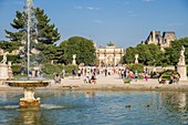 France, Paris, Jardin des Tuileries, the large round basin and the carroussel du Louvre at the bottom