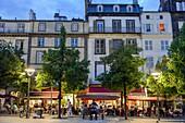 France, Puy de Dome, Clermont Ferrand, Place of Victoire, Café terraces on an esplanade at dusk
