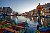 France, Herault, Sete, Quay Louis Pasteur, colored traditional boats moored to in pickets at dusk