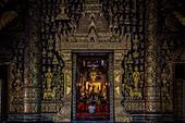 Monks chant at Wat Xieng Thong temple in Luang Prabang, Laos, Asia