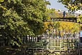 France, Paris, Bassin de la Villette, the largest artificial body of water in Paris, lock that links the Canal de l'Ourcq to the Canal Saint-Martin, cruise on the canals