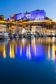 France, South Corsica, Bonifacio, the ramparts of the citadel floodlit seen since the port of the low city
