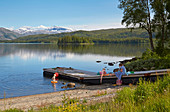 Bathing at Lake Fustvatnet near Mosjoen, Nordland, Norway, Europe