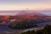 Dawn red from the eruption of the roughness over the landscape of the Bromo-Tengger-Semeru National Park, Java Island, Indonesia, Asia