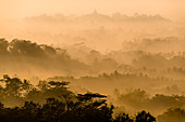 Early fog over Borobudur. Seen from Situmbu Hill, Java Island, Indonesia, Southeast Asia, Asia
