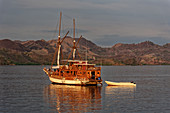 Sailboat in front of the island of Rinca in the Komodo National Park, Komodo Island, Indonesia, Southeast Asia, Asia