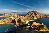 Mountains of the island Padar in the Komodo National Park, on the horizon the island Komodo, Indonesia, Southeast Asia, Asia