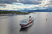 Hurtigruten - ship in Finnsnes on Gisundet, Senja island, Troms, Norway, Europe