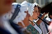 France, Var, Sanary sur Mer, the port, traditional Provencal dances during Heritage Days, musician, galoubet