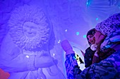 France, Savoie, Tarentaise valley, Vanoise massif, Arcs 2000 ski resort, a mother shows her daughter a giant Inuit snow sculpture in the wall of the igloo village bar room, during the winter season 2017-2018
