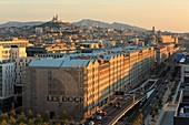 France, Bouches du Rhone, Marseille, Euromediterranee zone, La Joliette area, Les Docks, Boulevard du Littoral, the A55 motorway from the Silo, Notre Dame de la Garde basilica
