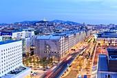 France, Bouches du Rhone, Marseille, Euromediterranee zone, La Joliette district, Les Docks, Henri Verneuil square, the A55 motorway from the Silo, Notre Dame de la Garde basilica
