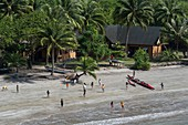 France, French Polynesia, Marquesas archipelago, Ua Pou island, Hakahau, children on the beach, outrigger canoe
