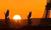 France, Paris, area listed as World Heritage by UNESCO, Opera Garnier roof and Eiffel Tower in the background at sunset