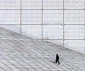 France, Hauts de Seine, Puteaux, a man climbs the stairs of the Grande Arche de la Défense