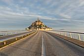 France, Manche, bay of Mont Saint Michel listed as World Heritage by UNESCO, pedestrian footbridge by architect Dietmar Feichtinger and Mont Saint Michel