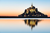 France, Manche, Mont Saint Michel Bay listed as World Heritage by UNESCO, Abbey of Mont Saint Michel illuminated at dusk