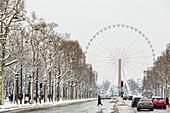 France, Paris, Avenue des Champs Elysees, Obelisque de la Concorde and the Grande Roue, snowfalls on 07/02/2018