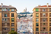 France, Bouches du Rhone, Marseille, Vieux Port, the Pouillon and Notre Dame de la Garde buildings