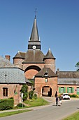 France, Aisne, Parfondeval, labeled the Most Beautiful Villages of France, Saint Medard fortified church, couple to walk