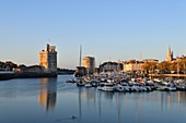 France, Charente-Maritime, La Rochelle, the Vieux Port (Old Port) with Saint Nicolas tower and Chain tower left and Tour de la Lanterne (Lantern tower)